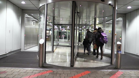 revolving door of a hotel: people, tourists come to the hotel Live Action