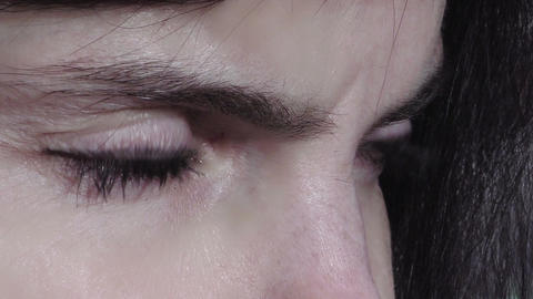 closeup footage on the eyes of a sad woman Footage