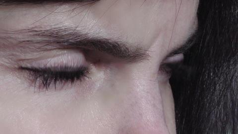 closeup footage on the eyes of a sad woman Footage