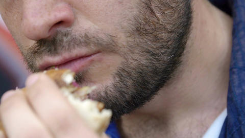 closeup footage on mouth of young man eating a sandwich Footage