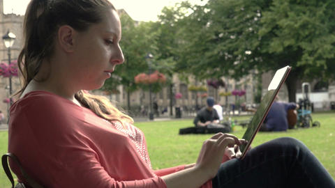 Young Woman With Tablet Computer In Park Footage