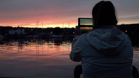 making photos of a beautiful and breathless sunset with a tablet computer Footage