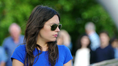 sad woman in the city: beautiful woman with sunglasses deep in her thoughts Footage