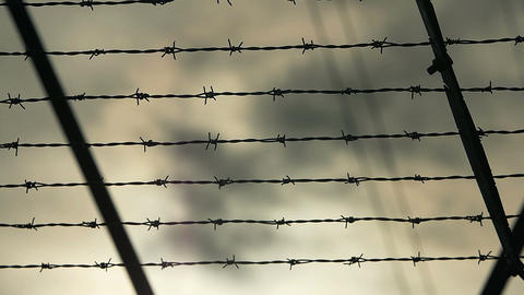 Outside of a prison camp barb wire fence Footage