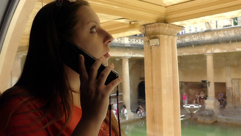 young woman visiting a museum using an audio guide Footage