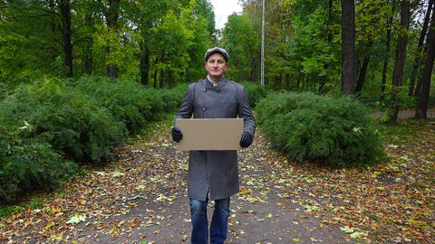 Man hold empty carton plate, look straight while come towards camera, slowmo Footage