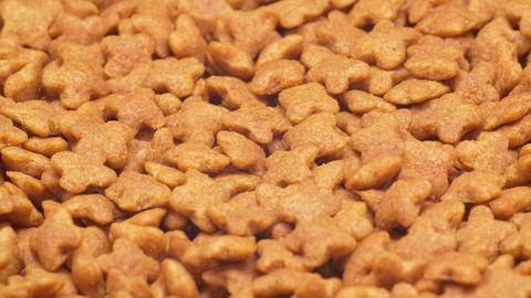 UHD closeup shot of the dry healthy dog or cat food on a turntable Live Action