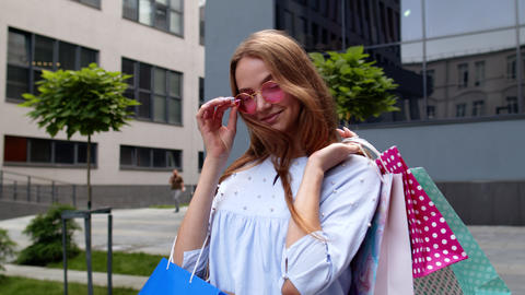 Student teen girl with shopping bags. Good Black Friday holiday sale discounts Live Action