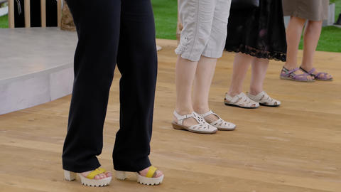 Elderly women legs dancing at fitness exhibition: slow motion, close up Live Action