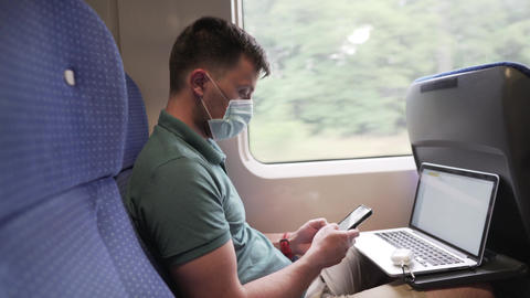 Rail transport and passenger transportation covid 19 pandemic. Caucasian man in Live Action