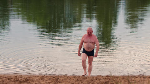 26-21-1-X- A Man Swims And Rests On The Lake. 0