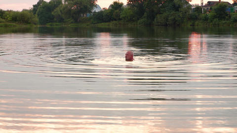 26-21-1-X- A Man Swims And Rests On The Lake. 1