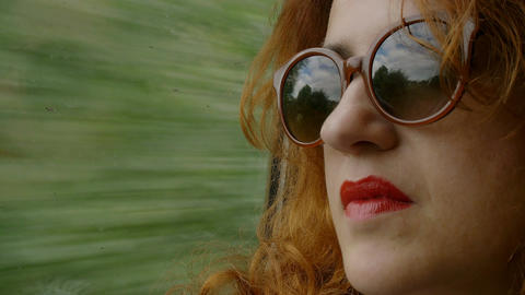 pensive woman looking outside the window sitting on the train Footage