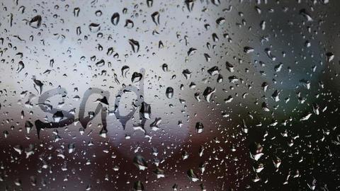 Sadness written on rainy window Footage