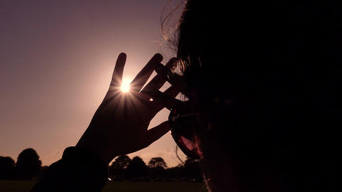 young woman looking the sun with hand protecting her eyes Footage