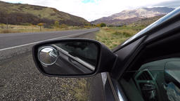 Traffic POV window rear view mirror mountain valley HD 948 Footage