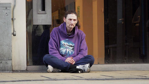 homeless on the ground asking the charity Footage