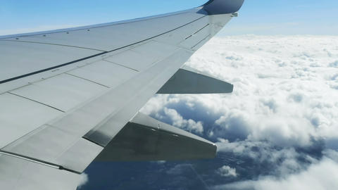Fly over clouds formation,airliner plane wing view,travel freedom,transport 4k Live Action