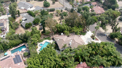 Aerial view of large-scale wealthy residential villa with swimming pool Live Action