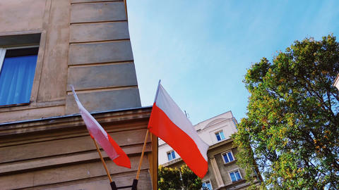 Red and white polish flag on a building in Warsaw, Poland, national independence Live Action