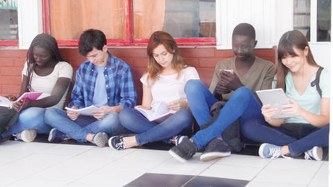 Group of multi ethnic teenagers seated at school doing lesson. Back to school Live Action