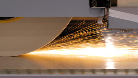 Surface grinding wheel machine working with sheet metal at factory - close up Live Action