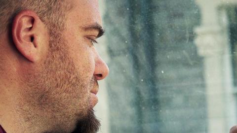pensive man smoking near the window Footage