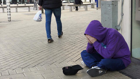homeless asking charity at the corner: poor man, jobless, clochard Footage