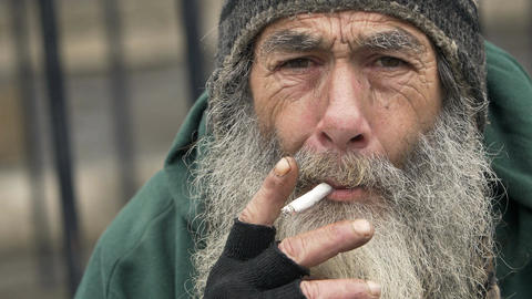 old homeless smoking: closeup portrait of a real homeless Footage