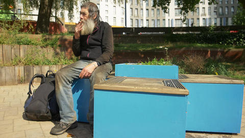 old man, jobless, homeless sitting in the city and smoking Footage
