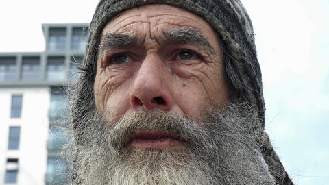 face of a real homeless man living in the streets of an England city Footage