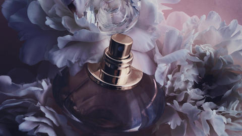 Purple perfume bottle with peony flowers, chic fragrance scent as luxury Live Action