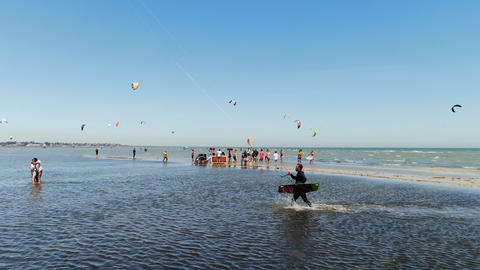 27.07.2020, Genichesk, Ukraine, beach party and kite surfers at the back, 4k ライブ動画