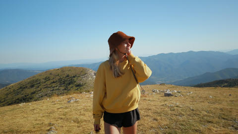 Young woman on sunny hike enjoy nature in mountain ライブ動画