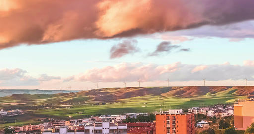 time-lapse scene with city, hills and wind turbine alternative renewable energy in background, from Live Action