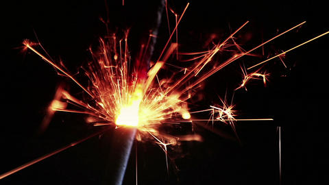 close-up of firework sparkler burning on black background, congratulation greeting party happy new 실사 촬영