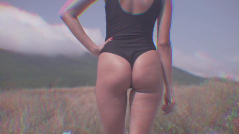 A hot woman in a swimsuit is dancing with cdistorsion lens effect, R6B effect. A Live Action