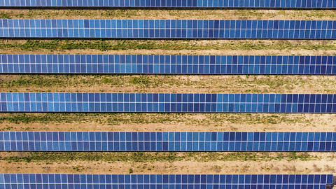 Solar power station with solar panels in a rows on field for producing energy. Aerial view 실사 촬영