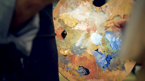 Artist brush mix color oil painting on palette Footage