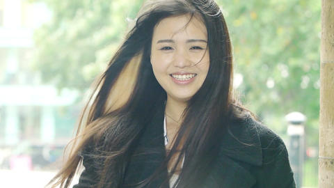 smiling young adult asian woman portrait: beautiful chinese woman portrait Live Action