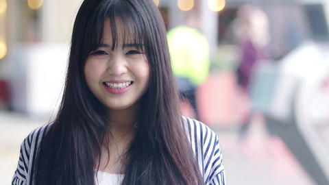 happy smiling young asian woman: chinese woman portrait Live Action