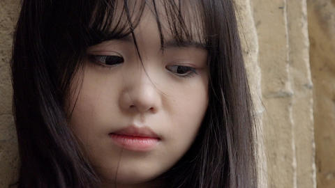 sad and hopeless young asian woman portrait Live Action