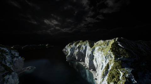 fjord with dark storm clouds GIF