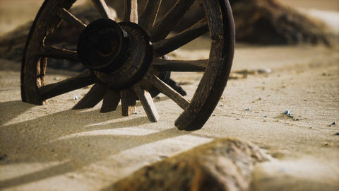 Large wooden wheel in the sand GIF