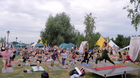 Group of people with trainer doing yoga exercises at forest - slow motion 실사 촬영