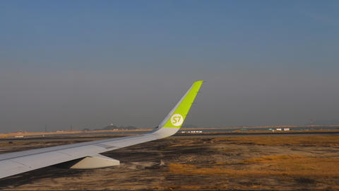 View from taxiing airliner at Chek Lap Kok airport GIF