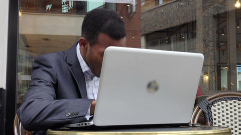 young tired businessman working with a laptop sitting in a cafe: overworked Footage