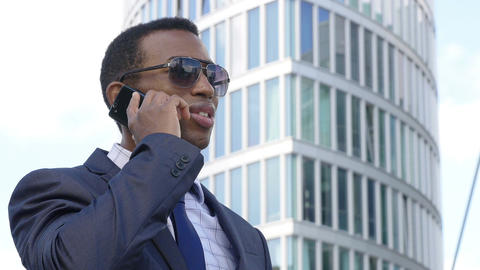 Young Businessman Talking On Mobile Phone In The City Footage
