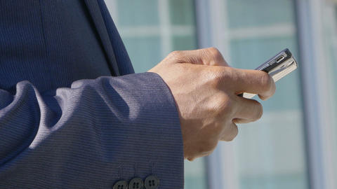 hands of a young black businessman texting with smartphone Footage