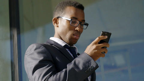 young African American Businessman Using Mobile Phone to send Email Footage
